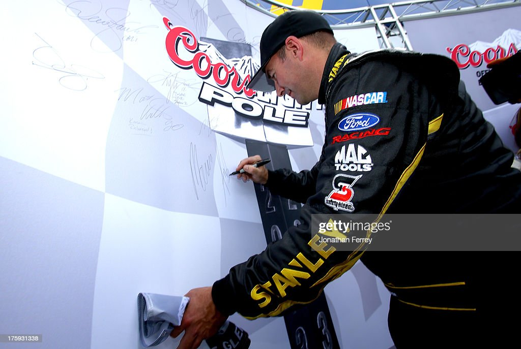 <a gi-track='captionPersonalityLinkClicked' href=/galleries/search?phrase=Marcos+Ambrose&family=editorial&specificpeople=179434 ng-click='$event.stopPropagation()'>Marcos Ambrose</a>, driver of the #9 Stanley/CTC Jumpstart Ford, signs the Pole Award after qualifying on the pole for the NASCAR Sprint Cup Series Cheez-It 355 at The Glen at Watkins Glen International on August 10, 2013 in Watkins Glen, New York.