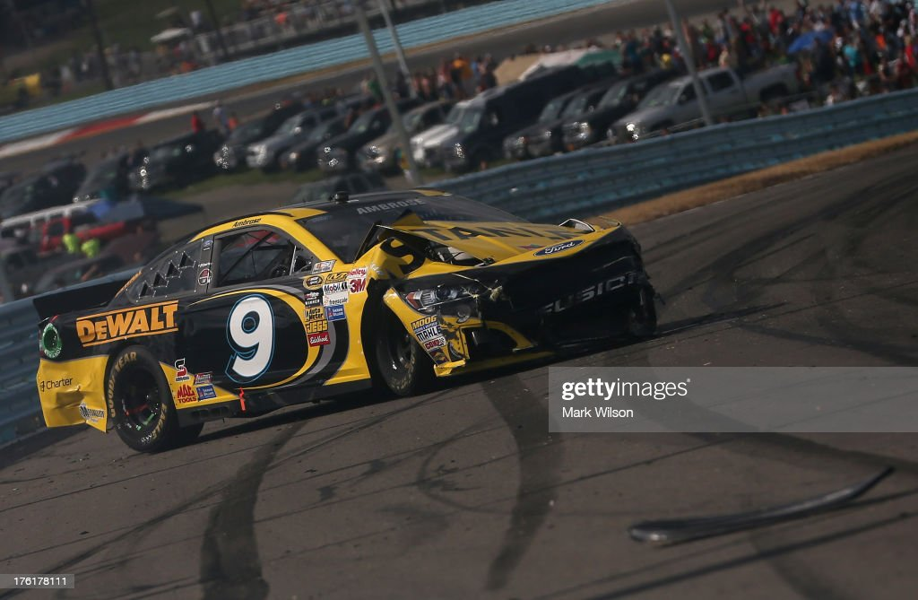 <a gi-track='captionPersonalityLinkClicked' href=/galleries/search?phrase=Marcos+Ambrose&family=editorial&specificpeople=179434 ng-click='$event.stopPropagation()'>Marcos Ambrose</a>, driver of the #9 Stanley/CTC Jumpstart Ford, sits on the track after an incident during the NASCAR Sprint Cup Series Cheez-It 355 at The Glen at Watkins Glen International on August 11, 2013 in Watkins Glen, New York.