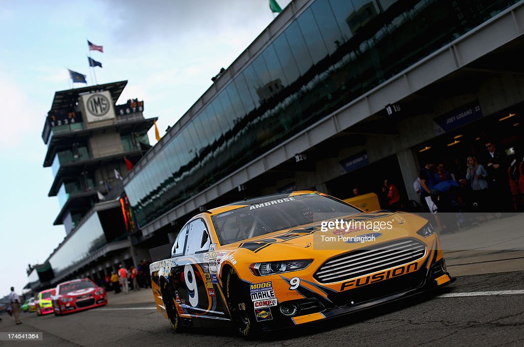 Marcos Ambrose drives the #9 DeWalt Ford through the garage area during practice for the NASCAR Sprint Cup Series Samuel Deeds 400 At The Brickyard at Indianapolis Motor Speedway on July 27, 2013 in Indianapolis, Indiana.