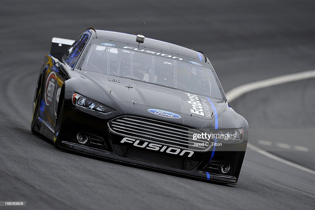 Marcos Ambrose drives the Richard Petty Motorsports Ford during testing at Charlotte Motor Speedway on December 12, 2012 in Concord, North Carolina.
