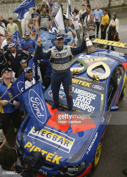 Marcos Ambrose of the Pirtek Racing Team celebrates winning the 2003 Supercar Championship after race two of the VIP Pet Foods Main Event in round 13...