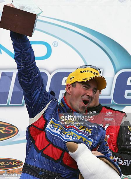 Marcos Ambrose of the Stone Brothers Racing Team celebrates the round win after the final round of the V8 Supercar Championship Series at the Phillip...