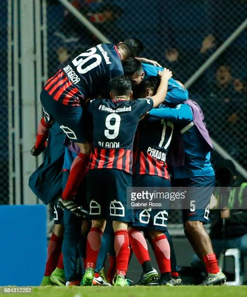 Marcos Angeleri of San Lorenzo celebrates with teammates after scoring the first goal of his team during a group stage match between San Lorenzo and...