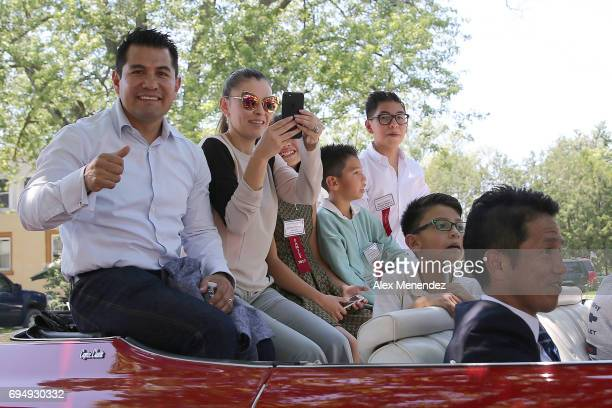 Marcos Antonio Barrera is seen with his family as they participate in a parade during the International Boxing Hall of Fame induction Weekend of...