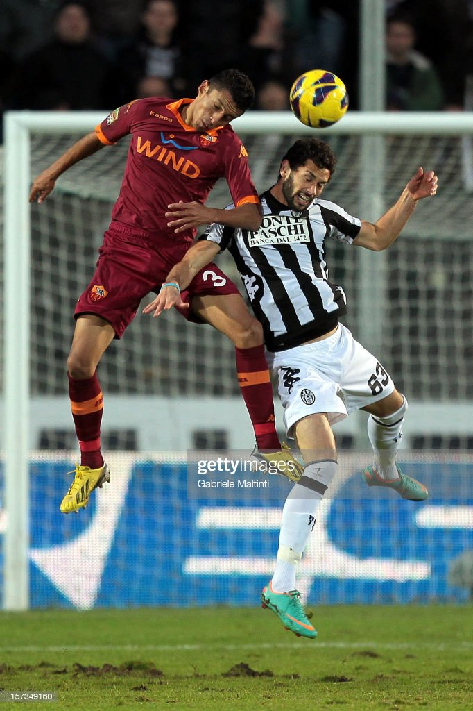Marcos Aoas Marquinhos of AC Siena fights for the ball with Marcelo Larrondo of AS Roma during the Serie A match between AC Siena and AS Roma at Stadio Artemio Franchi on December 2, 2012 in Siena, Italy.