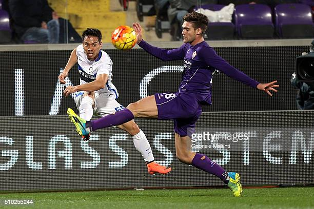 Marcos Aslonso of ACF Fiorentina battles for the ball with Yuto Nagatomo of FC Internazionale Milano during the Serie A match between ACF Fiorentina...