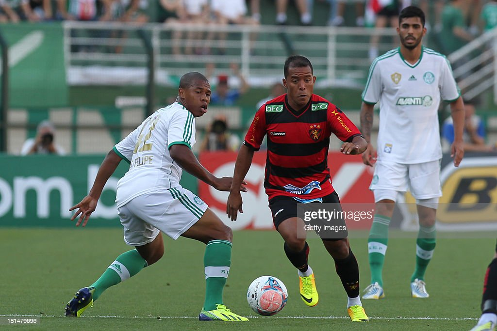 Marcos Aurelio, from Sport, passes Luis Felipe, from Palmeiras, watched by Vilson, from Palmeiras, during the match between Palmeiras and Sport for the Brazilian Series B 2013 at Pacaembu stadium on September 21, 2013 in Sao Paulo, Brazil.