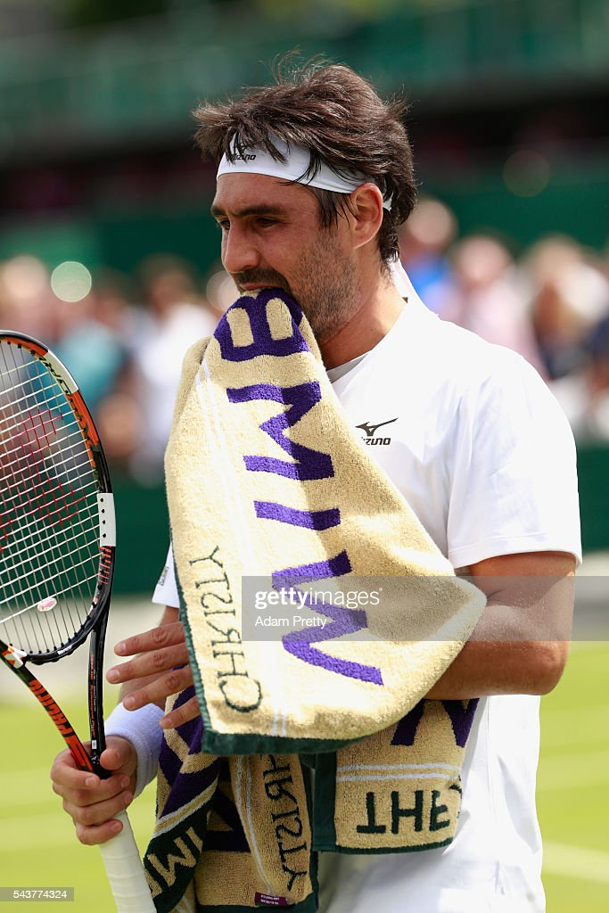 Marcos Baghadatis of Cyprus look dejected following defeat during the Men's Singles first round match against John Isner of The United States on day four of the Wimbledon Lawn Tennis Championships at the All England Lawn Tennis and Croquet Club on June 30, 2016 in London, England.