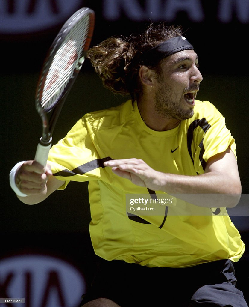 <a gi-track='captionPersonalityLinkClicked' href=/galleries/search?phrase=Marcos+Baghdatis&family=editorial&specificpeople=226943 ng-click='$event.stopPropagation()'>Marcos Baghdatis</a> attacks the ball during his fourth-round match against <a gi-track='captionPersonalityLinkClicked' href=/galleries/search?phrase=Roger+Federer&family=editorial&specificpeople=157480 ng-click='$event.stopPropagation()'>Roger Federer</a> during during the 2005 Australian Open at Melbourne Park in Melbourne, Australia on January 23, 2005. Federer won the match 6-2, 6-2, 7-6 (7-4).