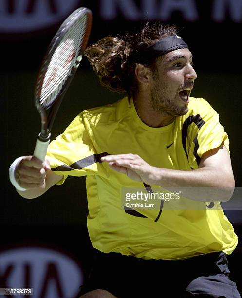 Marcos Baghdatis attacks the ball during his fourthround match against Roger Federer during during the 2005 Australian Open at Melbourne Park in...