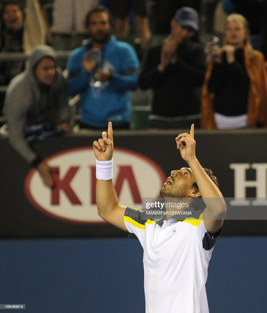 Marcos Baghdatis of Cyprus gestures as he celebrates after victory in his men's singles match against Albert Ramos of Spain on the first day of the Australian Open tennis tournament in Melbourne early January 15, 2013. AFP PHOTO/MANAN VATSYAYANA IMAGE STRICTLY RESTRICTED TO EDITORIAL USE - STRICTLY NO COMMERCIAL USE