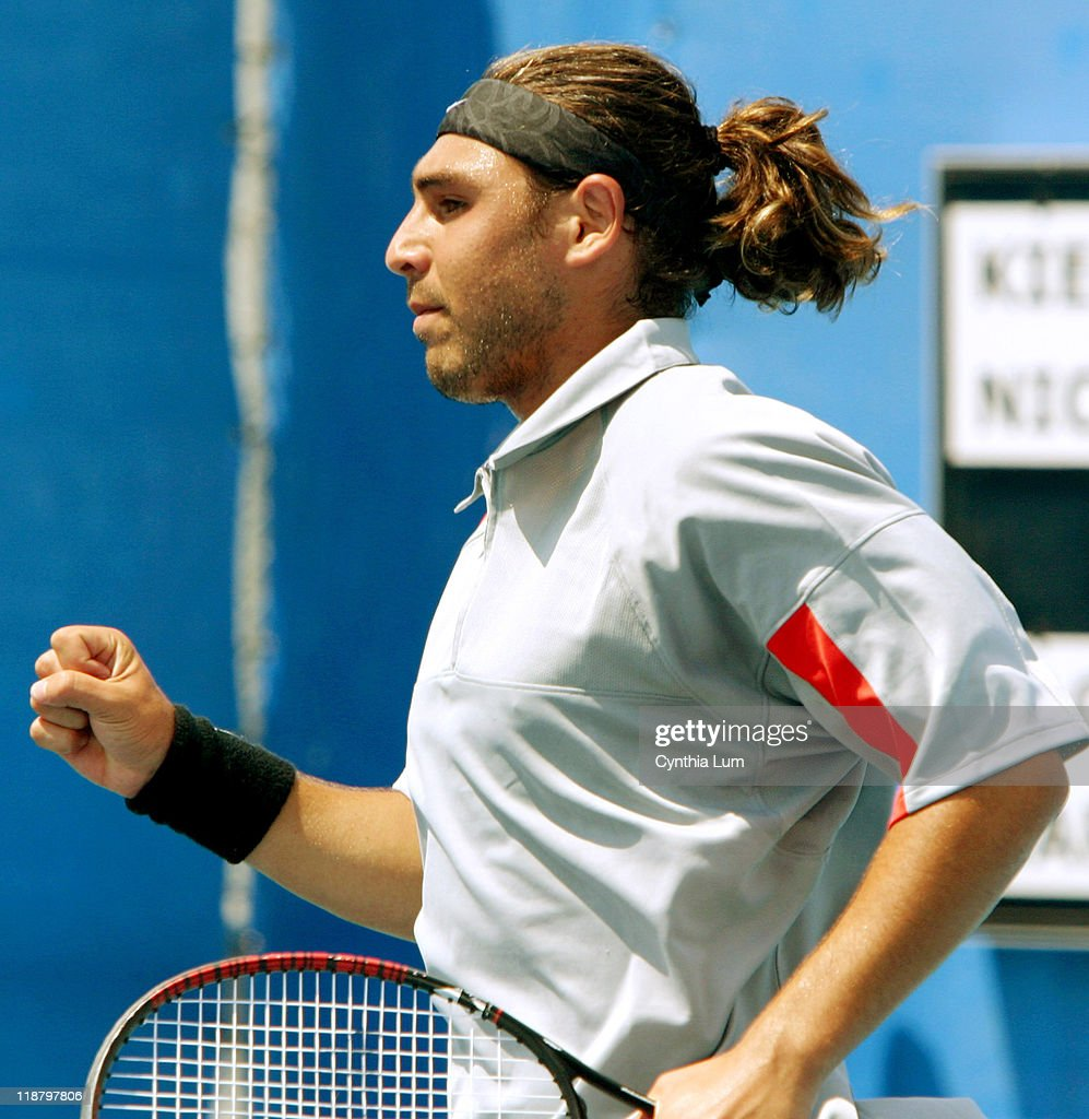 <a gi-track='captionPersonalityLinkClicked' href=/galleries/search?phrase=Marcos+Baghdatis&family=editorial&specificpeople=226943 ng-click='$event.stopPropagation()'>Marcos Baghdatis</a> of Cyprus gives clenched fist winning the second set in a match against <a gi-track='captionPersonalityLinkClicked' href=/galleries/search?phrase=Nicolas+Kiefer&family=editorial&specificpeople=171738 ng-click='$event.stopPropagation()'>Nicolas Kiefer</a> of Germany during the Athens 2004 Olympics Games at Goudi Olympic Hall in Athens, Greece on August 17, 2004. Kiefer won the set 6-2, 3-6, 6-3