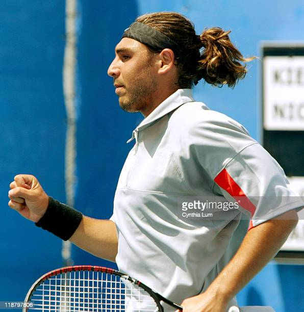 Marcos Baghdatis of Cyprus gives clenched fist winning the second set in a match against Nicolas Kiefer of Germany during the Athens 2004 Olympics...