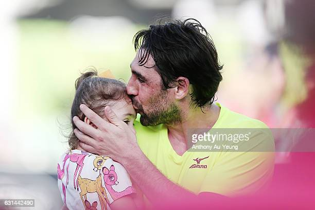 Marcos Baghdatis of Cyprus gives his daughter a kiss after winning his match against Dustin Brown of Germany on day ten of the ASB Classic on January...