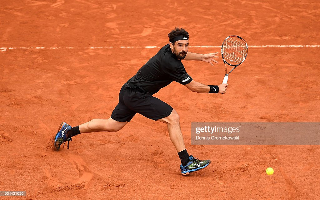 <a gi-track='captionPersonalityLinkClicked' href=/galleries/search?phrase=Marcos+Baghdatis&family=editorial&specificpeople=226943 ng-click='$event.stopPropagation()'>Marcos Baghdatis</a> of Cyprus hits a backhand during the Men's Singles second round match against Jo-Wilfried Tsonga of France on day five of the 2016 French Open at Roland Garros on May 26, 2016 in Paris, France.