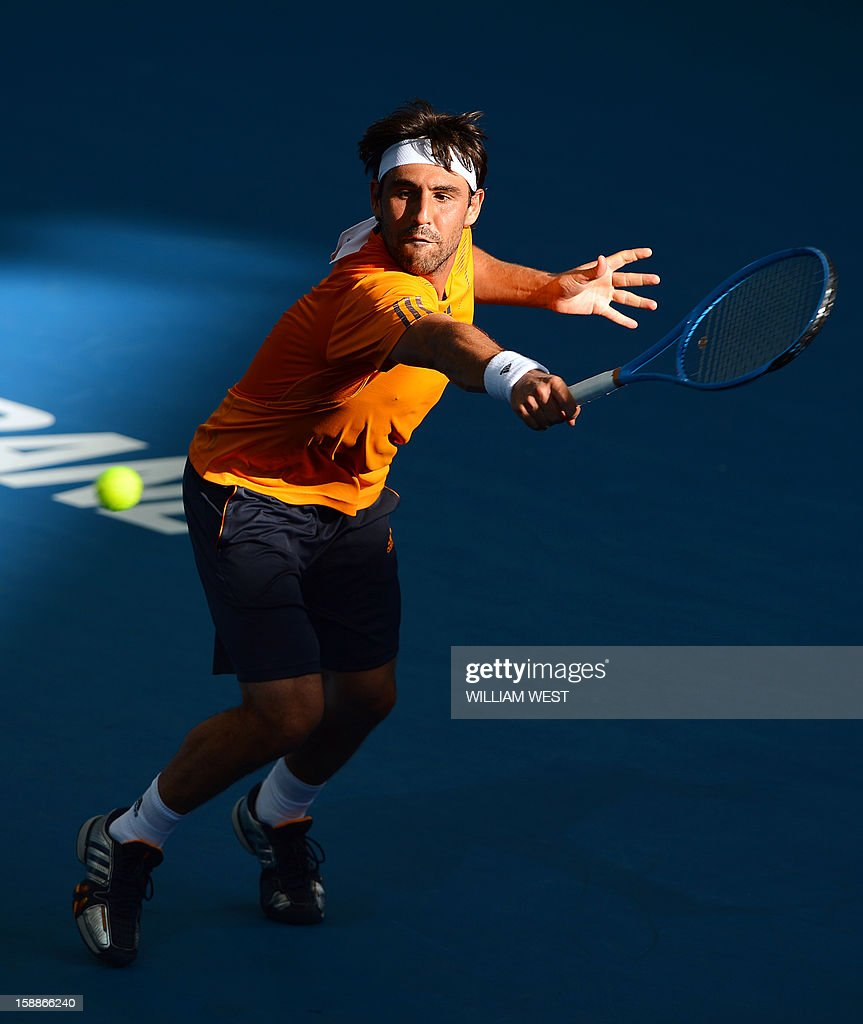 Marcos Baghdatis of Cyprus hits a backhand return on the way to victory orian Mayer of Germany in the second round at the Brisbane International tennis tournament on January 2, 2013. AFP PHOTO/William WEST USE