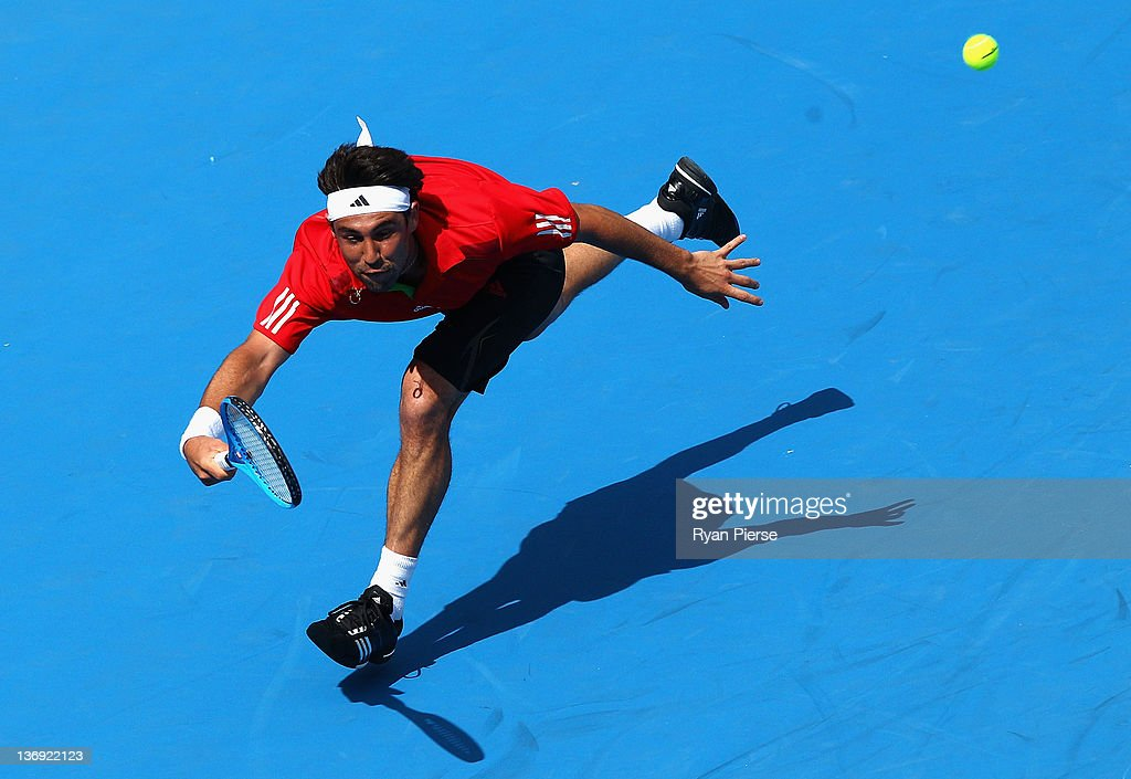 <a gi-track='captionPersonalityLinkClicked' href=/galleries/search?phrase=Marcos+Baghdatis&family=editorial&specificpeople=226943 ng-click='$event.stopPropagation()'>Marcos Baghdatis</a> of Cyprus hits a forehand during his semi final match against Julien Benneteau of France during day six of the 2012 Sydney International at Sydney Olympic Park Tennis Centre on January 13, 2012 in Sydney, Australia.