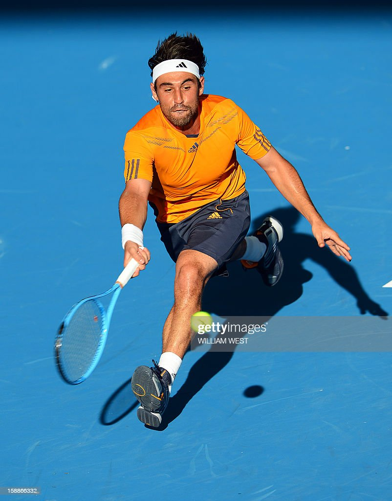 Marcos Baghdatis of Cyprus hits a forehand return on the way to victory orian Mayer of Germany in the second round at the Brisbane International tennis tournament on January 2, 2013. AFP PHOTO/William WEST USE