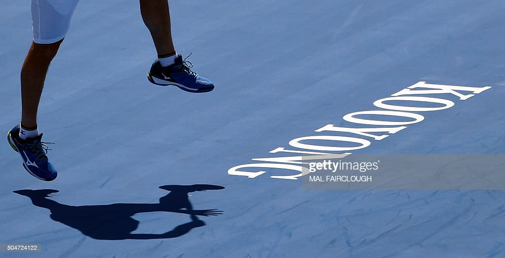 Marcos Baghdatis of Cyprus hits a return against Pablo Carreno Busta of Spain during their men's singles match on day two at the Kooyong Classic...