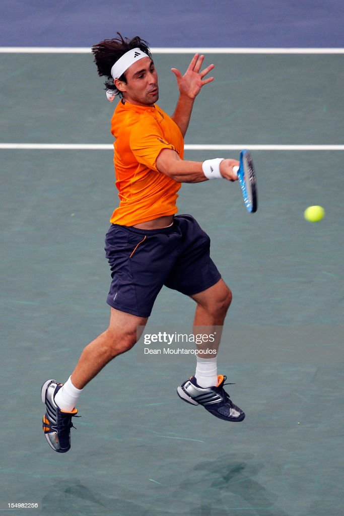 <a gi-track='captionPersonalityLinkClicked' href=/galleries/search?phrase=Marcos+Baghdatis&family=editorial&specificpeople=226943 ng-click='$event.stopPropagation()'>Marcos Baghdatis</a> of Cyprus in action against Gilles Simon of France during day 1 of the BNP Paribas Masters at Palais Omnisports de Bercy on October 29, 2012 in Paris, France.