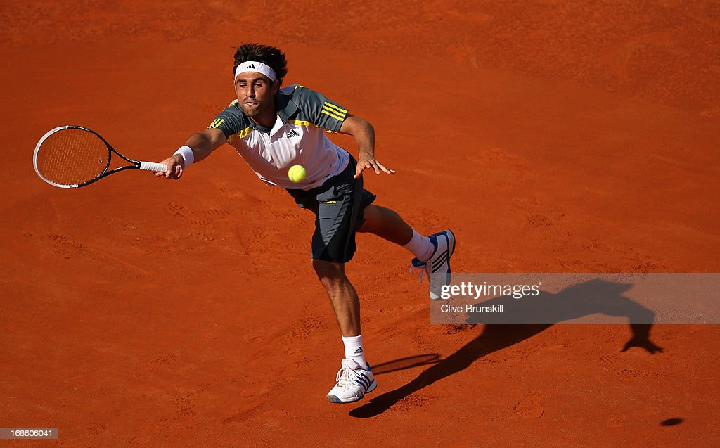 <a gi-track='captionPersonalityLinkClicked' href=/galleries/search?phrase=Marcos+Baghdatis&family=editorial&specificpeople=226943 ng-click='$event.stopPropagation()'>Marcos Baghdatis</a> of Cyprus in action against Grigor Dimitrov of Bulgaria in their first round match during day one of the Internazionali BNL d'Italia 2013 at the Foro Italico Tennis Centre on May 12, 2013 in Rome, Italy.