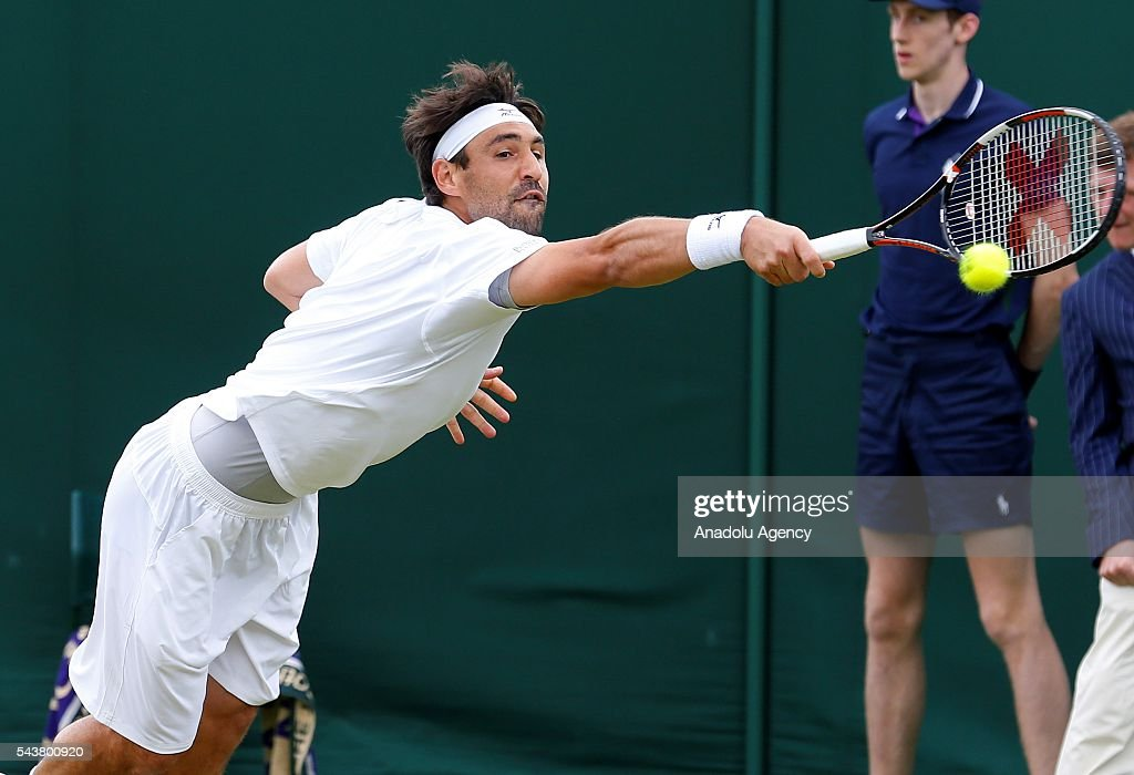 Marcos Baghdatis of Cyprus in action against John Isner of USA in the men's singles on day four of the 2016 Wimbledon Championships at the All England Lawn and Croquet Club in London, United Kingdom on June 30, 2016.