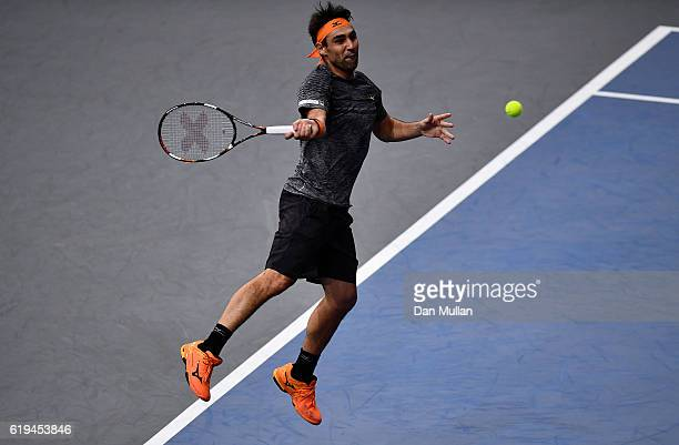 Marcos Baghdatis of Cyprus leaps for a forehand during his Mens Singles first round match against PaulHenri Mathieu of France on day one of the BNP...