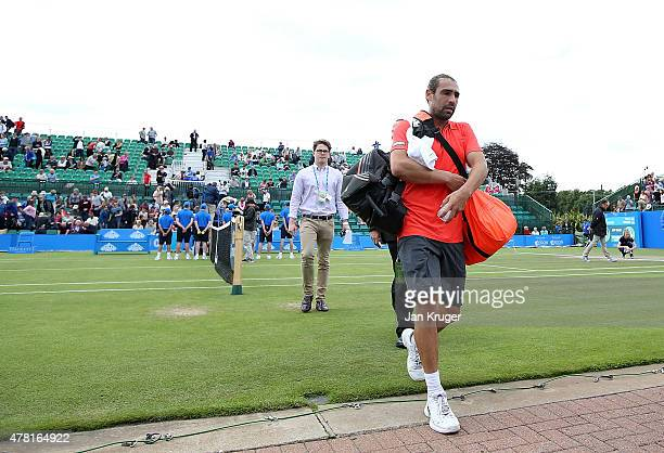 Marcos Baghdatis of Cyprus leaves the court after his victory over David Ferrer of Spain on day three of the Aegon Open Nottingham at Nottingham...