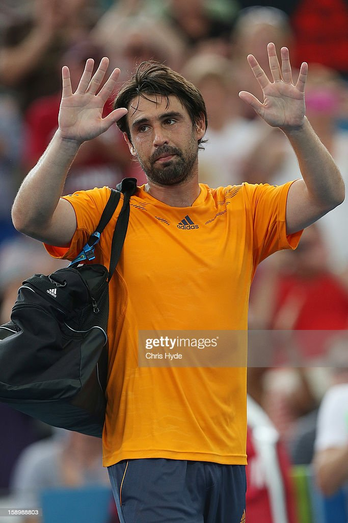 Marcos Baghdatis of Cyprus leaves the court after losing his semi final match against Grigor Dimitrov of Bulgaria on day seven of the Brisbane International at Pat Rafter Arena on January 5, 2013 in Brisbane, Australia.