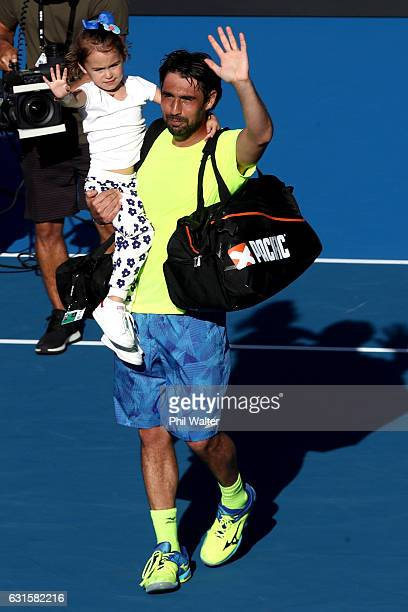 Marcos Baghdatis of Cyprus leaves the court with his daughter following his singles semifinal against Joao Sousa of Portugal on day 12 of the ASB...