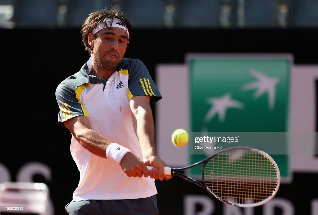 <a gi-track='captionPersonalityLinkClicked' href=/galleries/search?phrase=Marcos+Baghdatis&family=editorial&specificpeople=226943 ng-click='$event.stopPropagation()'>Marcos Baghdatis</a> of Cyprus plays a backhand against Grigor Dimitrov of Bulgaria in their first round match during day one of the Internazionali BNL d'Italia 2013 at the Foro Italico Tennis Centre on May 12, 2013 in Rome, Italy.