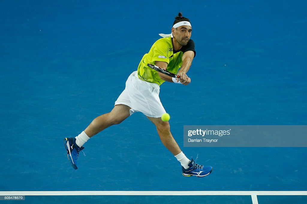 <a gi-track='captionPersonalityLinkClicked' href=/galleries/search?phrase=Marcos+Baghdatis&family=editorial&specificpeople=226943 ng-click='$event.stopPropagation()'>Marcos Baghdatis</a> of Cyprus plays a backhand in his first round match against Jo-Wilfried Tsonga of France during day one of the 2016 Australian Open at Melbourne Park on January 18, 2016 in Melbourne, Australia.