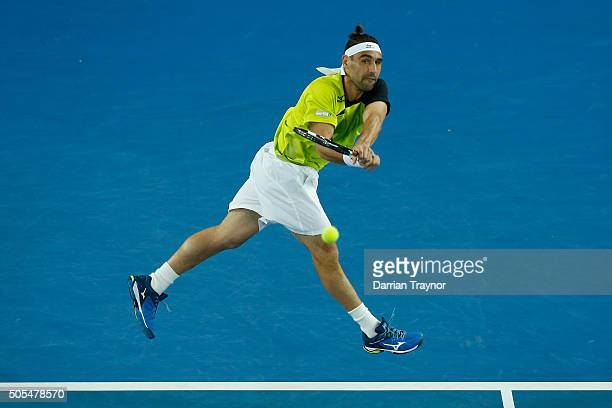 Marcos Baghdatis of Cyprus plays a backhand in his first round match against JoWilfried Tsonga of France during day one of the 2016 Australian Open...