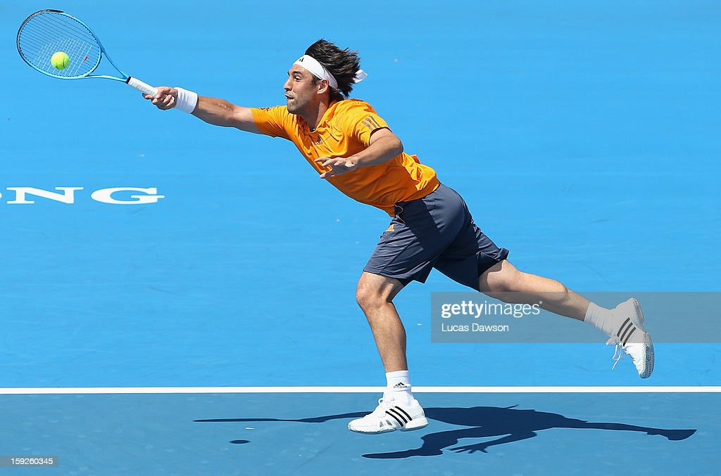<a gi-track='captionPersonalityLinkClicked' href=/galleries/search?phrase=Marcos+Baghdatis&family=editorial&specificpeople=226943 ng-click='$event.stopPropagation()'>Marcos Baghdatis</a> of Cyprus plays a forehand during his match against Juan Martin Del Potro of Argentina during day three of the AAMI Classic at Kooyong on January 11, 2013 in Melbourne, Australia.