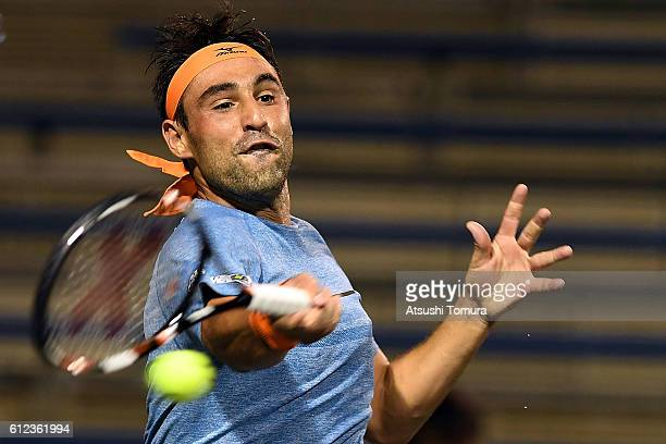 Marcos Baghdatis of Cyprus plays a forehand during the men's singles first round match against Marcel Granollers of Spain on day two of Rakuten Open...