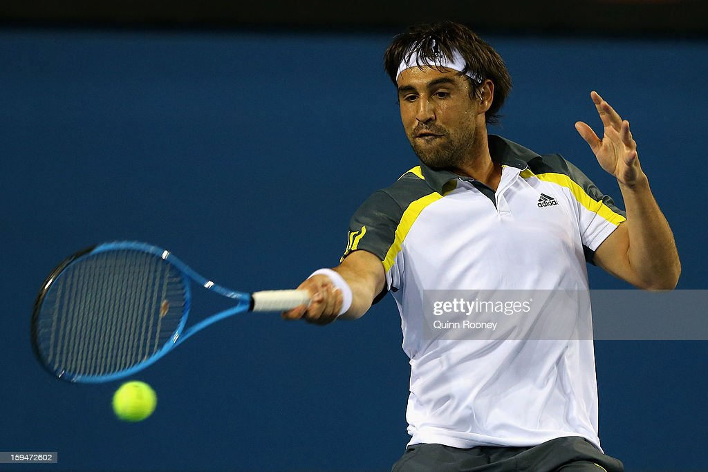 Marcos Baghdatis of Cyprus plays a forehand in his first round match against Albert Ramos of Spain during day one of the 2013 Australian Open at Melbourne Park on January 14, 2013 in Melbourne, Australia.
