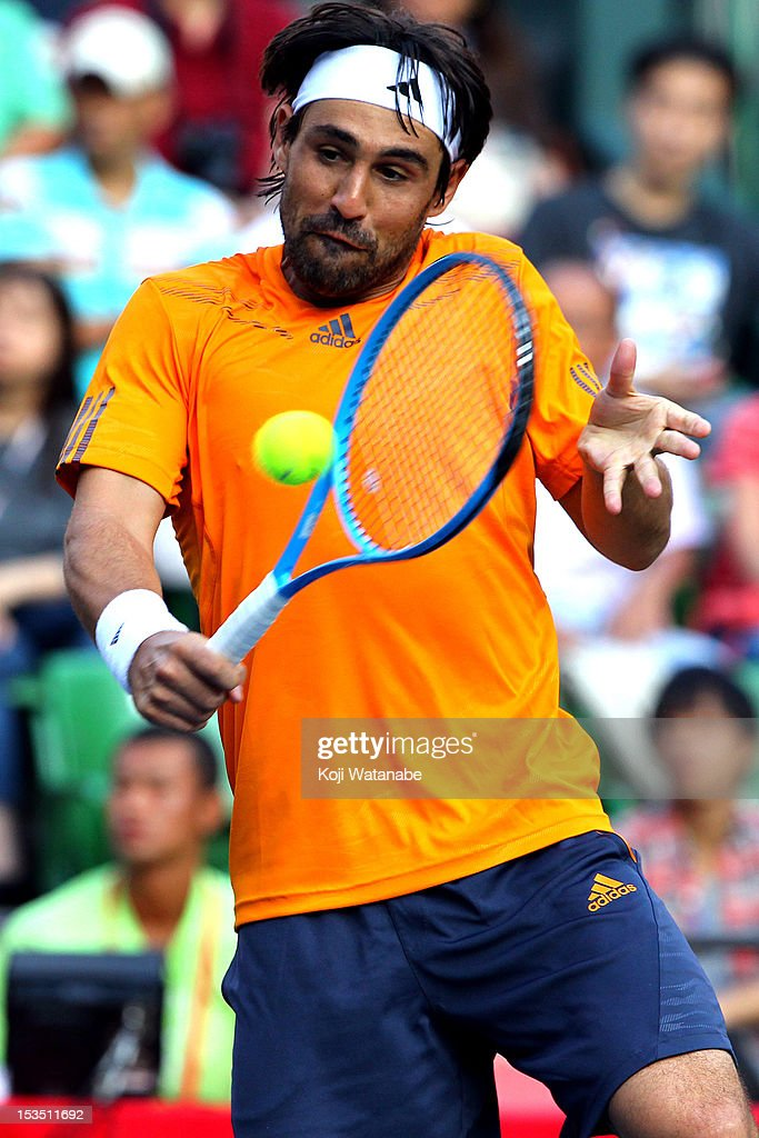 <a gi-track='captionPersonalityLinkClicked' href=/galleries/search?phrase=Marcos+Baghdatis&family=editorial&specificpeople=226943 ng-click='$event.stopPropagation()'>Marcos Baghdatis</a> of Cyprus plays a forehand in his match against Kei Nishikori of Japan during day six of the Rakuten Open at Ariake Colosseum on October 6, 2012 in Tokyo, Japan.