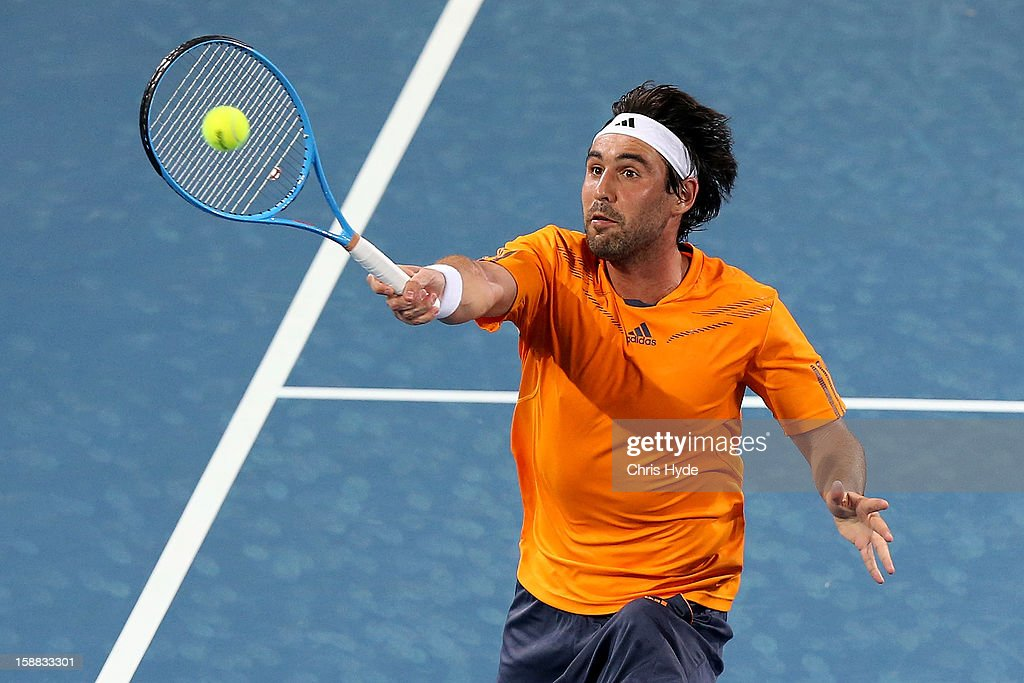 Marcos Baghdatis of Cyprus plays a forehand in his match against Benjamin Mitchell of Australia during day two of the Brisbane International at Pat Rafter Arena on December 31, 2012 in Brisbane, Australia.