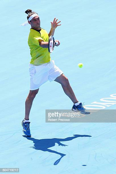 Marcos Baghdatis of Cyprus plays a forehand in his match against Pablo Carreno Busta of Spain during day two of the 2016 Kooyong Classic at Kooyong...