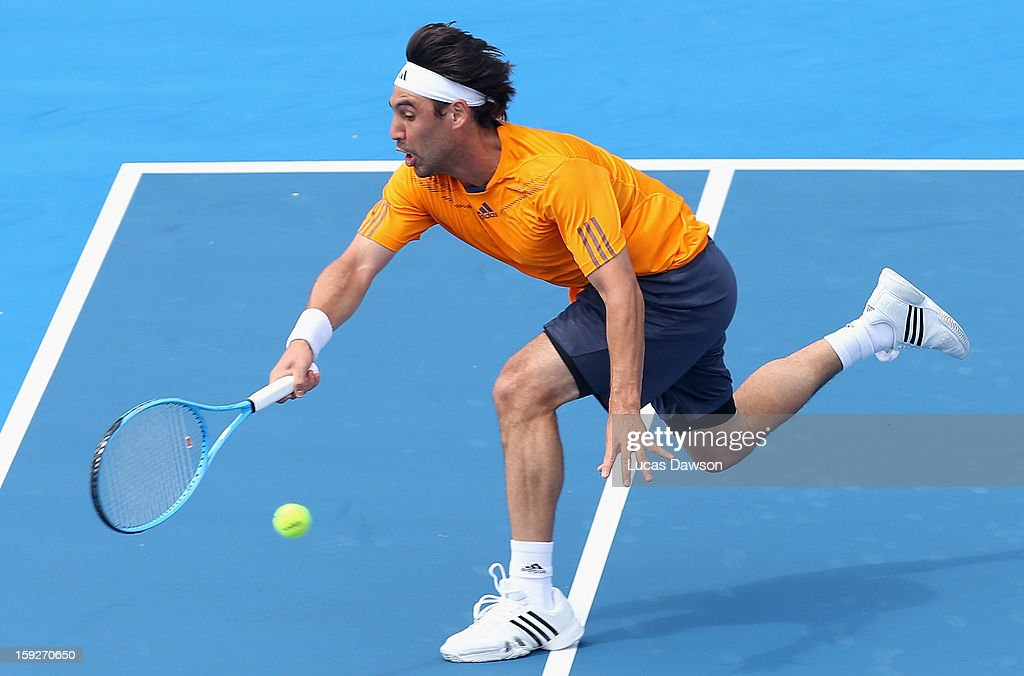 <a gi-track='captionPersonalityLinkClicked' href=/galleries/search?phrase=Marcos+Baghdatis&family=editorial&specificpeople=226943 ng-click='$event.stopPropagation()'>Marcos Baghdatis</a> of Cyprus plays a volley during his match against Juan Martin Del Potro of Argentina during day three of the AAMI Classic at Kooyong on January 11, 2013 in Melbourne, Australia.