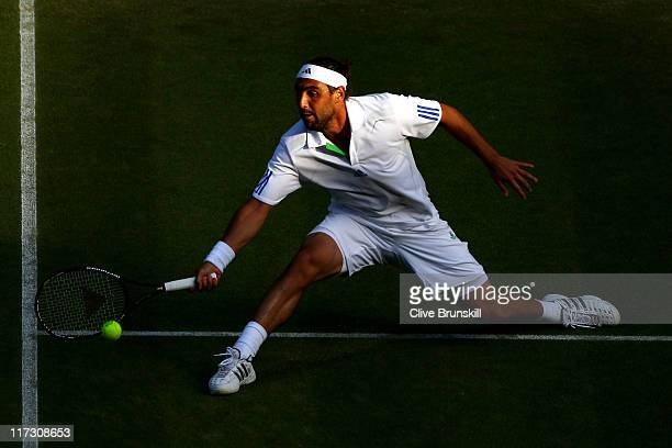 Marcos Baghdatis of Cyprus reaches for a shot during his third round match against Novak Djokovic of Serbia on Day Six of the Wimbledon Lawn Tennis...