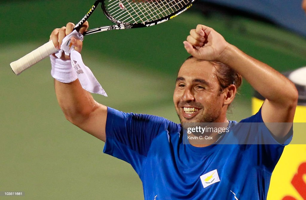 <a gi-track='captionPersonalityLinkClicked' href=/galleries/search?phrase=Marcos+Baghdatis&family=editorial&specificpeople=226943 ng-click='$event.stopPropagation()'>Marcos Baghdatis</a> of Cyprus reacts after defeating Rafael Nadal of Spain during Day 5 of the Western & Southern Financial Group Masters at the Lindner Family Tennis Center on August 20, 2010 in Cincinnati, Ohio.