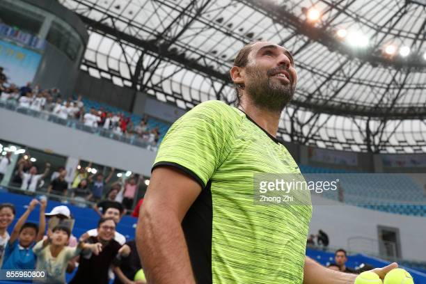 Marcos Baghdatis of Cyprus reacts after winning the semi final match against Guido Pella of Argentina during Day 6 of 2017 ATP Chengdu Open at...