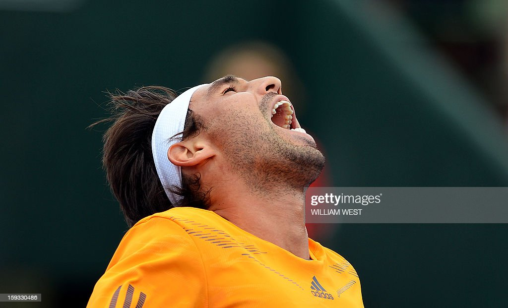 Marcos Baghdatis of Cyprus reacts during his loss to Tomas Berdych of the Czech Republic in the 3rd and 4th play-off match at the Kooyong Classic in Melbourne on January 12, 2013. AFP PHOTO/William WEST USE