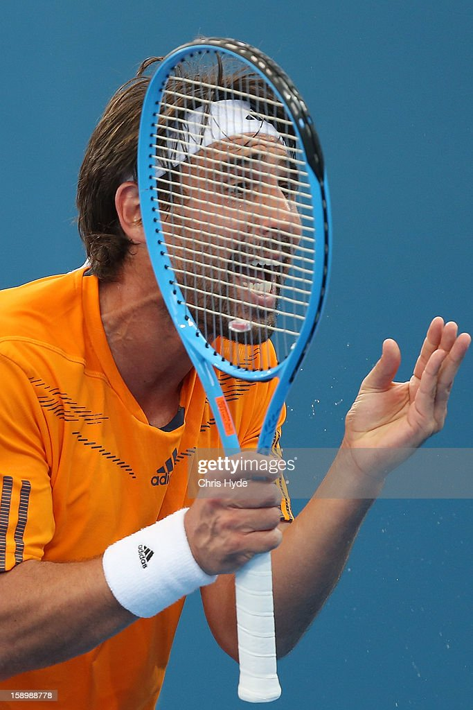 <a gi-track='captionPersonalityLinkClicked' href=/galleries/search?phrase=Marcos+Baghdatis&family=editorial&specificpeople=226943 ng-click='$event.stopPropagation()'>Marcos Baghdatis</a> of Cyprus reacts during his semi final match against Grigor Dimitrov of Bulgaria on day seven of the Brisbane International at Pat Rafter Arena on January 5, 2013 in Brisbane, Australia.