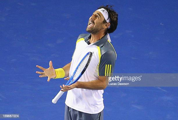Marcos Baghdatis of Cyprus reacts during his third round match against David Ferrer of Spain during day five of the 2013 Australian Open at Melbourne...