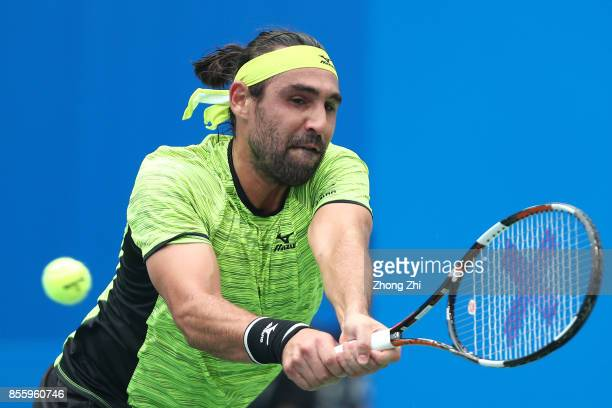 Marcos Baghdatis of Cyprus returns a shot during the semi final match against Guido Pella of Argentina during Day 6 of 2017 ATP Chengdu Open at...