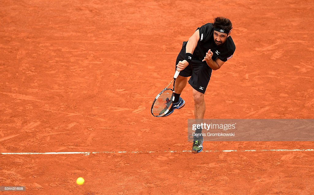 <a gi-track='captionPersonalityLinkClicked' href=/galleries/search?phrase=Marcos+Baghdatis&family=editorial&specificpeople=226943 ng-click='$event.stopPropagation()'>Marcos Baghdatis</a> of Cyprus serves during the Men's Singles second round match against Jo-Wilfried Tsonga of France on day five of the 2016 French Open at Roland Garros on May 26, 2016 in Paris, France.