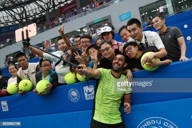Marcos Baghdatis of Cyprus takes selfie with fans after winning the semi final match against Guido Pella of Argentina during Day 6 of 2017 ATP...