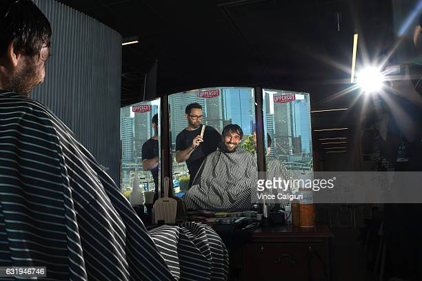 Marcos Baghdatis of Cyprus took time out from the courts to visit the barber at the players services lounge during day three of the 2017 Australian...